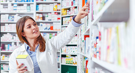 A pharmacist looking at some tablets